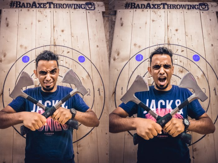Guy holding two axes at Bad Axe Throwing Montreal