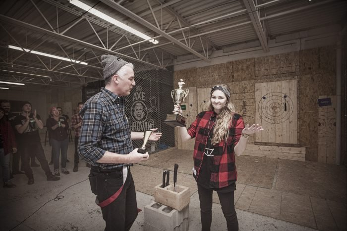 crowning an axe throwing champion during corporate event