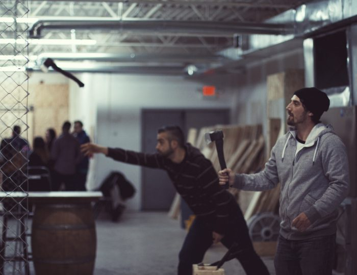 Boys throwing axes for Bachelor Party