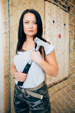 Axe throwing coach Edyta holding axe in Toronto