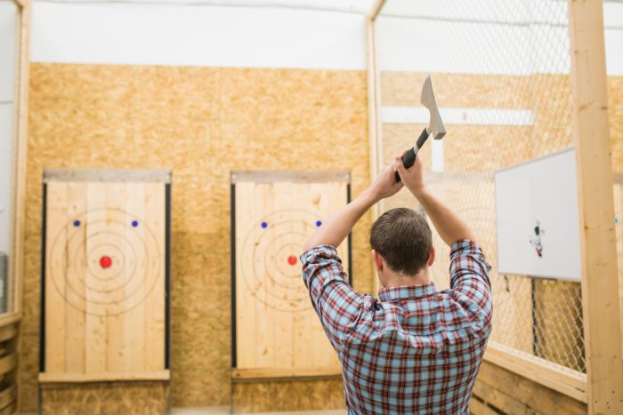 Urban axe throwing venue and participant