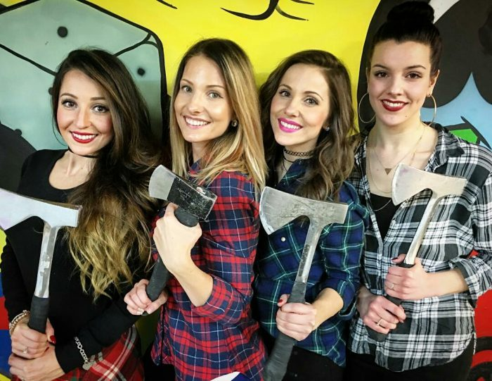 Girls holding axes at Bad Axe Throwing