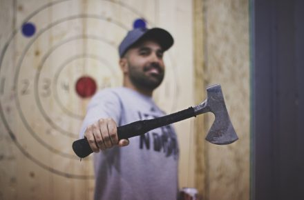 Patron holding an axe at Bad Axe Throwing Mississauga