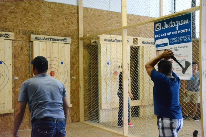 Axe throwing at a wooden target