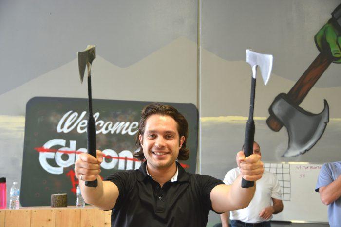Holding axes at Bad Axe Throwing Edmonton