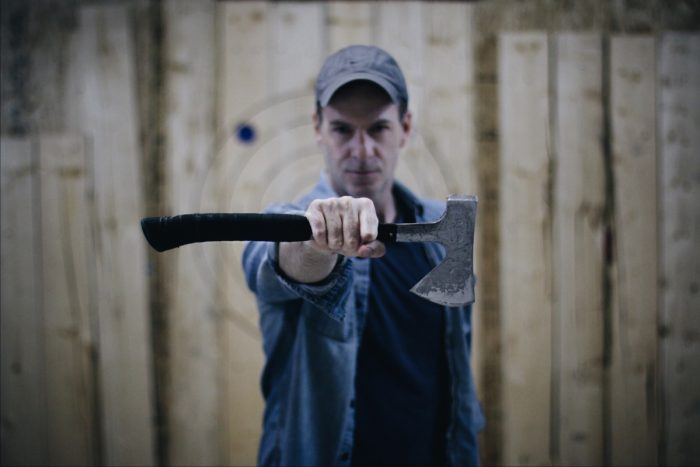 Axe Throwing Coach holding Axe